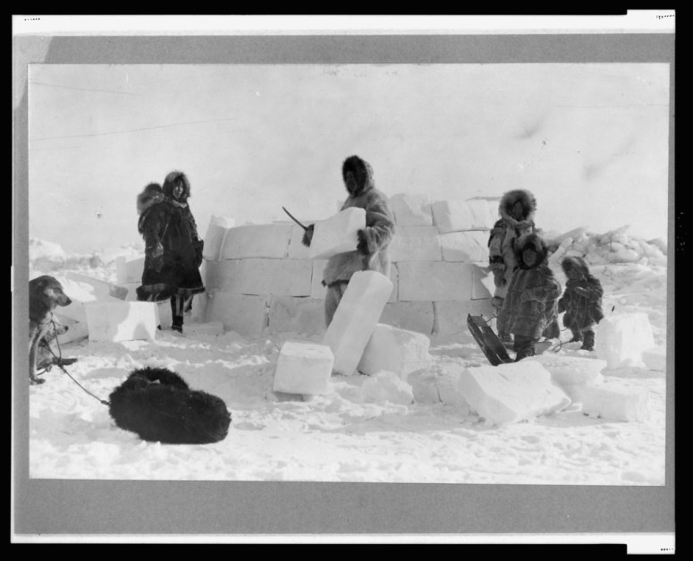 "Inuit building an igloo out of ""skare"""